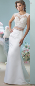 Two-piece satin dress set, illusion jewel neck over lace sweetheart cropped top with cap sleeves, illusion back, and hand-beaded band at bottom, high waist satin trumpet skirt with beaded waistband and chapel length train.  SIZES 0 – 20  COLORS Ivory/Nude, White