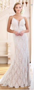 This drop-dead-gorgeous sleeveless stretch beaded lace sheath features beaded spaghetti straps that cascade into triple back straps, a deep plunging curved V-neckline with an illusion inset trimmed in hand-beading, matching beading at the natural waist and at the low back, and a lace inset skirt with a scalloped hem and chapel train.  SIZES 0 – 20  COLORS Diamond White/Nude, Diamond White