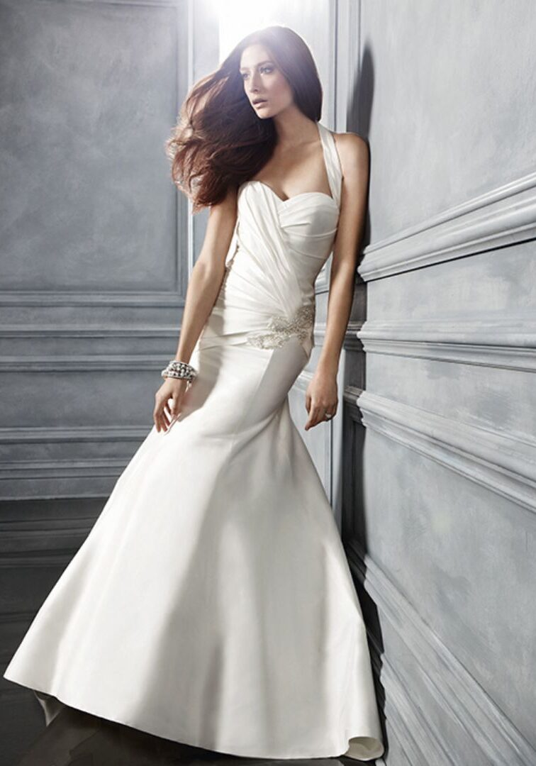 """Silk Shantung halter, ruched bodice gown with a silver crystal and rhinestone with freshwater pearl beaded bow appliqué at the hip, the back bodice has matching Silk Shantung buttons and a detachable silver crystal and rhinestone """"T"""" strap going down the middle of the back."""