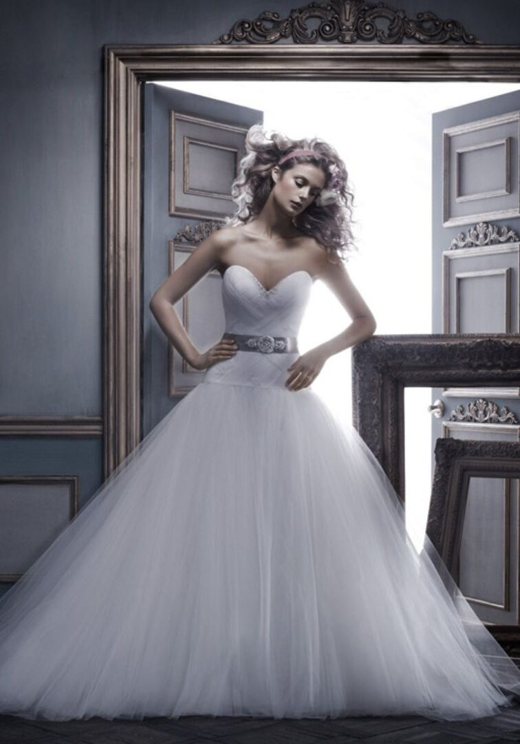 Soft Tulle ball gown with lattice pleating on bodice and a beaded and embroidered satin sash. Swarovski Crystals and rhinestones emphasize the sweetheart neckline and crystal buttons along the zipper.  Fabric: Soft Tulle over satin Available In: Ivory/Gold/Silver, Ivory/Ivory/Silver, White/White/Silver, Ivory/Black/Silver, Ivory/Black/Silver Shown In: Ivory/Gold/Silver